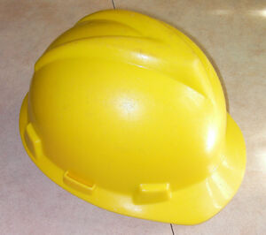Yellow hard safety hat (helmet) and liner
