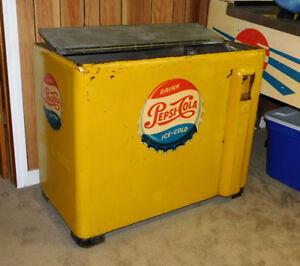 Old vintage yellow Pepsi pop soda machine Working