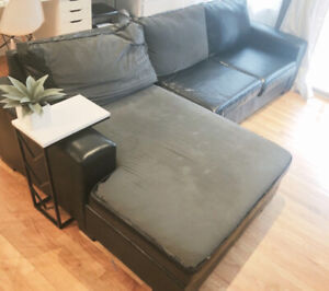 150$ 9feet by 5feet black bonded leather couch