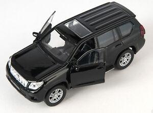 BLITZ VERSAND Toyota Land Cruiser Prado schwarz Welly Modell Auto 1:34 NEU OVP