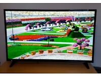 Sharp 40 inch Smart TV with Wifi built in and all apps like Youtube, Netflix etc..