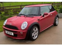 2006 Mini One with factory JCW kit and half leather interior. Excellent Condition.