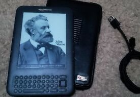 Amazon Kindle - model D00901 with hard case, USB lead and books