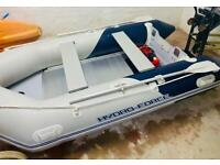 Inflatable boat and outboard package