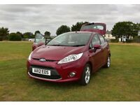 2012 Ford Fiesta 1.25 Zetec, *7,400* miles. 5 dr., 5 speed. One owner. A/C. Garaged from new.