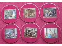 "Set of 6 TABLE MATS, 8"" dia. Red, center colourful pictures past times, gold colourededging"