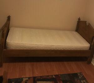 Antique rustic wood single bed. Wood slat construction.