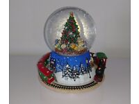 Musical and moving train snow globe decoration