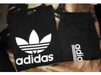 Black Adidas shorts and top