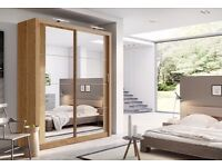 Brand new oak 2 door slide robe with large mirrors on the front doors