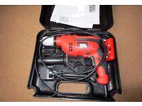Black & Decker 710W drill with wire/pipe detector