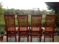 4 solid teak high backed dining chairs (very expensive when new)