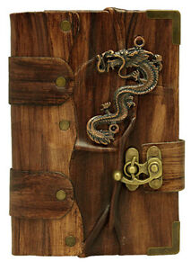 Dragon-Sculpture-on-a-Brown-Leather-Bound-Journal-Notebook-Diary-Sketchbook