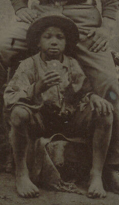 SOLDIER WITH SMALL BLACK BOY / CUBA?