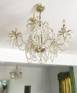 Gorgeous vintage chandelier with brass palm leaf details