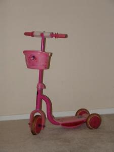 Pink three wheel scooter
