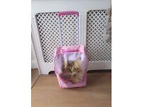 Girls pink wheeled suitcase cat
