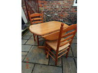 Solid wood (small) kitchen table, plus 2 chairs (Teak?)