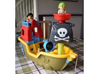 Pirate ship with wheels, music, sound effects and firing cannon (Mega Bloks)