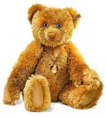 This bear features silk, gold, sapphires and diamonds
