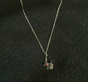 Silver chained dog pendant