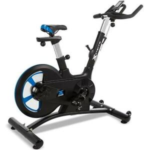 FREE SHIPPING - BRAND NEW SILENT SPINNING BIKE WITH A 48.5 LBS FLYWHEEL AND 8 LEVEL OF RESISTANCE