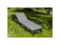 new boxed grey rattan effect sun lounger with cushions on offer at £84.99