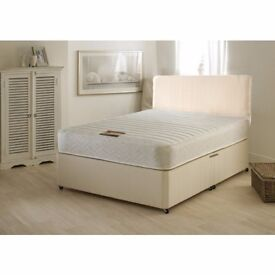 new double memory sprung mattress and base with a free head board