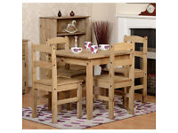 A BRAND NEW waxed pine wooden dining table set with 4 chairs