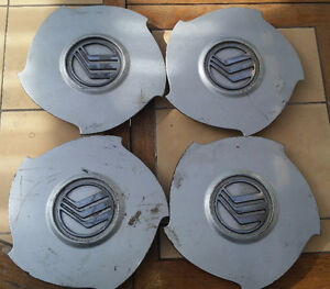 Set of 4 OEM Mercury Villager center caps