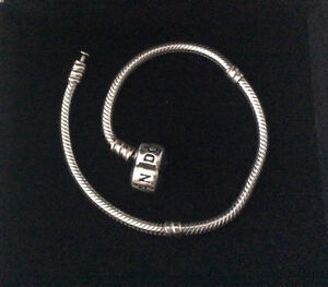 Pandora bracelet45$ 14k charm35$