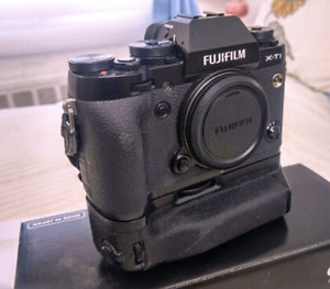 Fuji xt-1 camera body with battery grip. Excellent