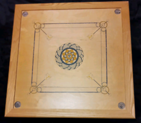 Carrom board game with accessories