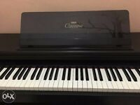 Yamaha Clavinova C-123 Electric Piano excellent condition lovely sound and feel: no tuning required!