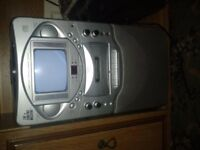 The singing machine with Compact disc, cassette player, graphics TV Karaoke STV505