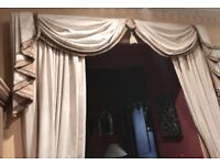 Two pairs of fully-lined long curtains with theatrical swags, rails, hooks etc.