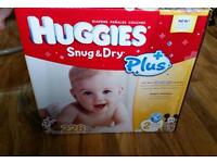 Full box of 228 Huggies snug and dry nappies, size 2
