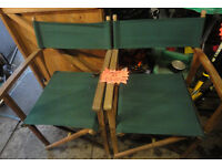 A NICE PAIR OF GREEN MARTIAL AND WOODEN GARDEN CHAIRS