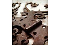 Pair of antique vintage elaborate iron hinges.
