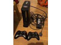 Xbox 360 console, power pack, 2 controllers and multiple games (USED)