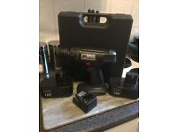 Cordless drill 18v comes with charger and 2 18 V batteries case and drill sets full working order