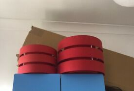 Two red lampshades - one small one large