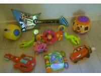 Toys bundle cookie jar, guitars, buggy syeering wheel and more!