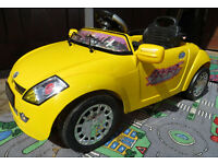 Childs ride-on/remote controlled yellow sports car