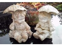 Two stone welcome garden ornaments