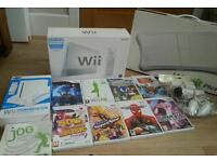 Nintendo wii complete console with wii fit board Nintendo wii stand and games