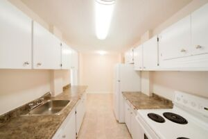 2 and 3 Bdrms Available! Garage Parking & In-Suite Laundry!