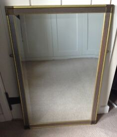 Rectangular mirror with gold coloured border