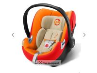 Cybex Aton q car seat with isofix base, footmuff and rain cover.