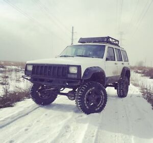 1992 Jeep Xj with parts Jeep and spare motor
